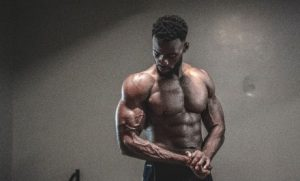 colored man working out with optimal bicep volume