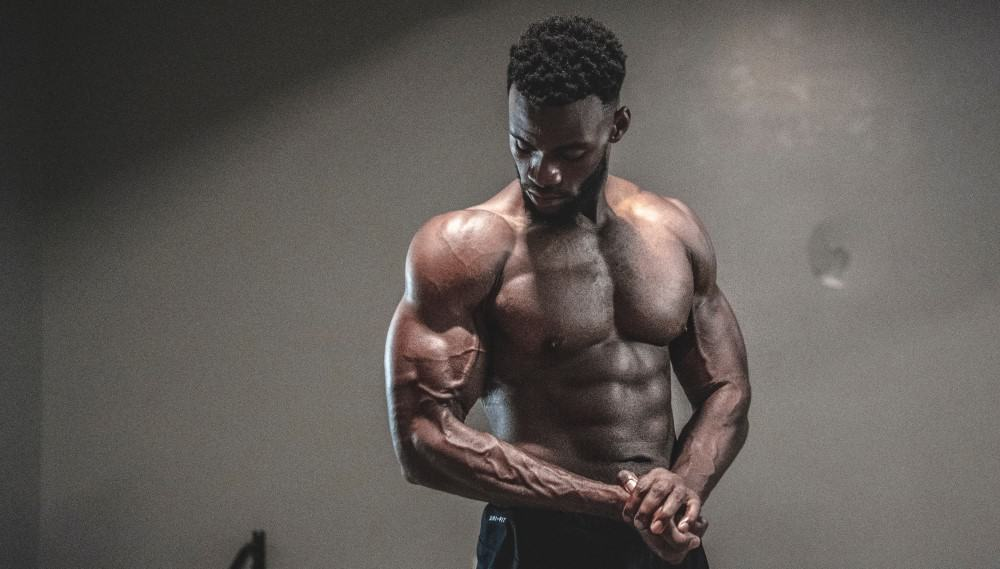 Black emerging athlete learns how to build muscle