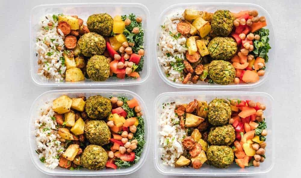 Four lunchboxes with prepared food