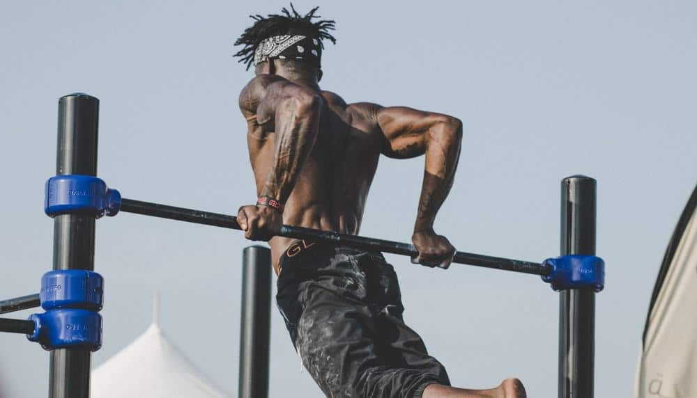 Black man exercising on a bar