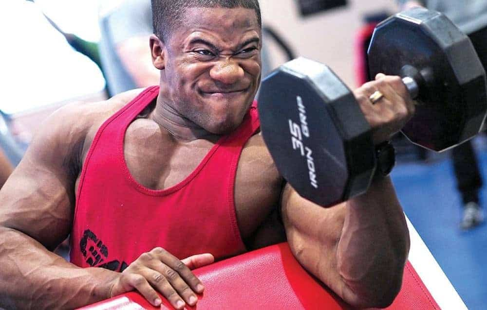 Black man doing biceps curls