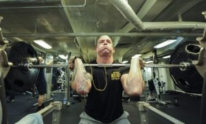 Man doing heavy front squats for the optimal quads volume