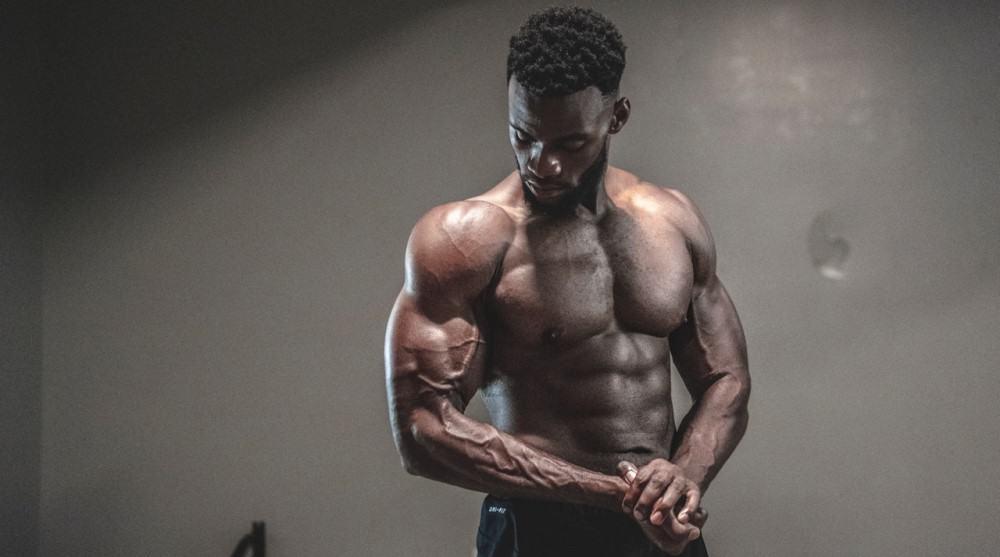 Black man flexing after DoggCrapp Training System