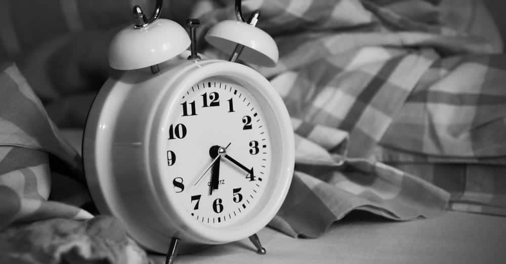 Alarm clock in a bed
