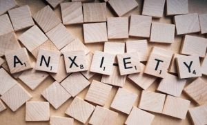"The word ""anxiety"" spelled out in scrabble"