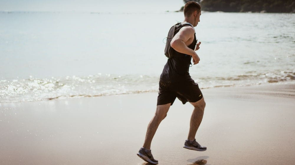 Man jogging on a beach