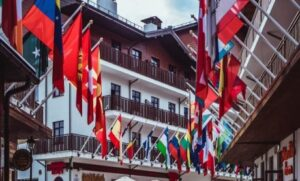 Multinational flags hanging from buildings representive different languages and countries